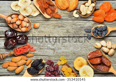 Mix of dried fruits and nuts - symbols of judaic holiday Tu Bishvat. Copyspace background.Top view.