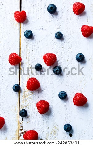 Mix of fresh berries on white wooden background. Top view. - stock photo