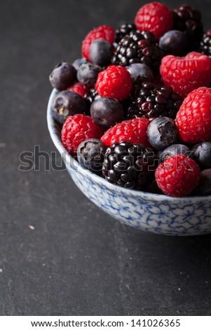 Mix of fresh blueberries, rasberries and strawberries. Shallow dof - stock photo