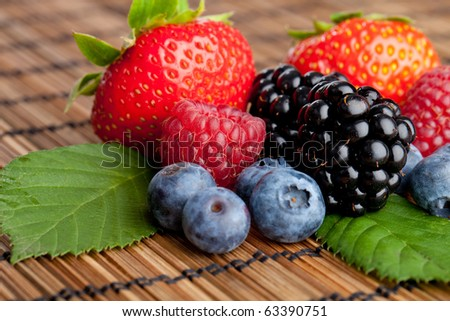Mix of fresh healthy berries - stock photo