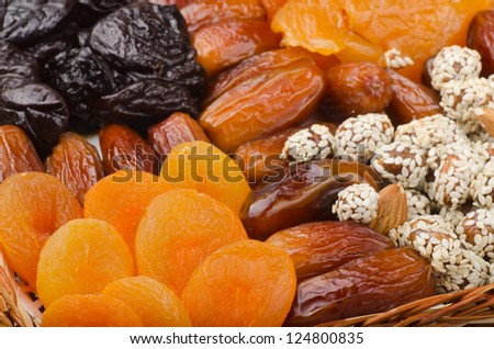 Mix of healthy dried fruits and nuts - stock photo