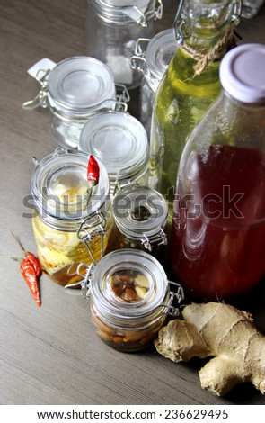 Mix of homemade canned delicious food in the beautiful jars  - stock photo