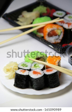 Mix of Japanese sushi and rolls on the table