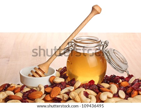 Mix of kernel And A Jar Of Golden Light Honey With A Honey Dipper - stock photo