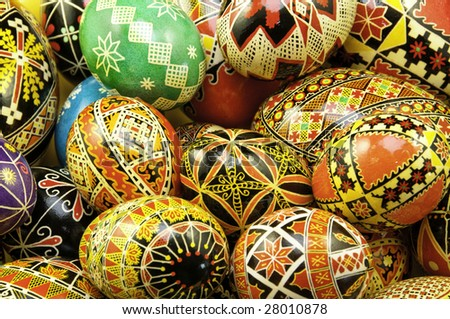 Mix of large and small eggs with the traditional designs on the eggs. - stock photo