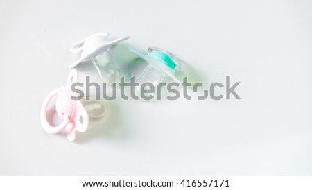 Mix of multi-color physiological teat or pacifier with silicone rubber for newborn baby. Isolated on empty background. Slightly de-focused and close-up shot. Copy space.