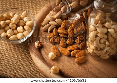 mix of nuts on a wooden table - stock photo