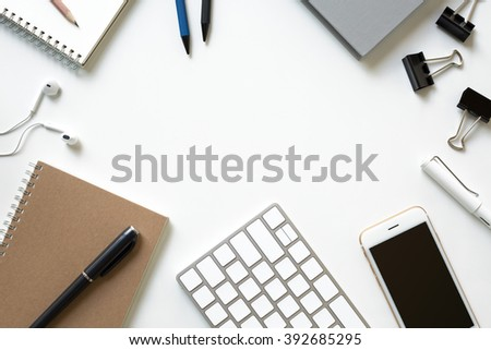 Mix of office supplies and business gadgets on a modern office desk - stock photo