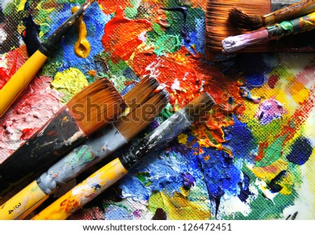 Mix of panits and paintbrushes - stock photo