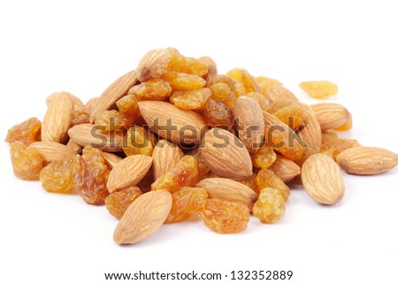 Mix of raisins and almonds on white - stock photo