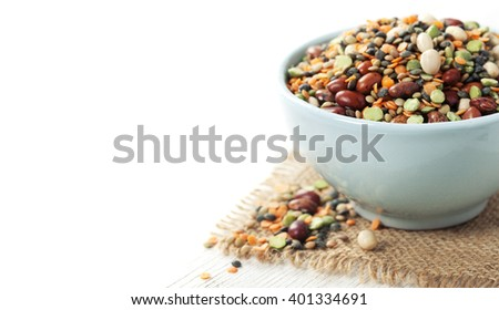 Mix of red  bean, lentil, green peas and chickpea over white - stock photo