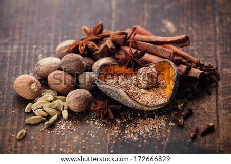 Mix of spices nutmeg, cinnamon, star anise, cloves, cardamom - stock photo