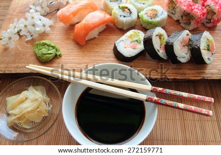 Mix of sushi with soy sauce and wooden chopsticks