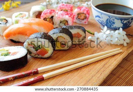 Mix of sushi with wooden chopsticks