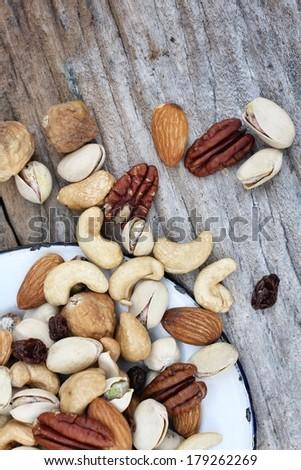 Mix of tasty nuts - almond, fig, raisin, cashew, macadamia and  pecan - stock photo