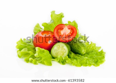 Mix of tomatoes and cucumber on a salad isolated on white background