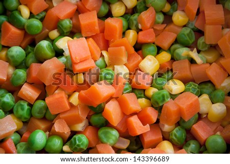 Mix of vegetable containing carrots, peas, and corn. - stock photo
