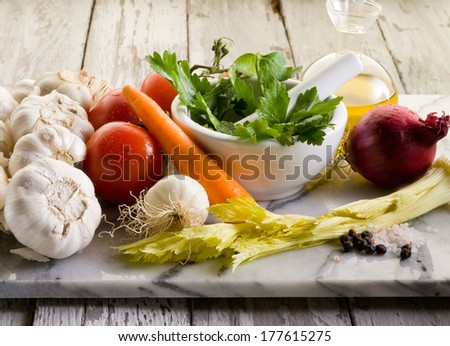 mix of vegetables ingredients over marble  - stock photo