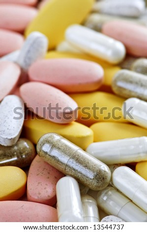 Mix of vitamins and herbal supplements close up - stock photo