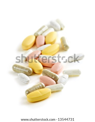 Mix of vitamins and herbal supplements on white background - stock photo