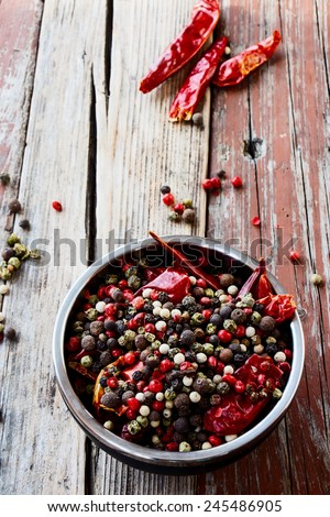 mix pepper on rustic wooden background/ mixture of peppers hot pepper, red pepper, black pepper, white pepper, green pepper, background. Selective focus. - stock photo