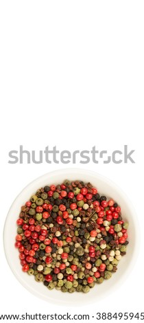 Mix peppercorn variety in white bowl over white background
