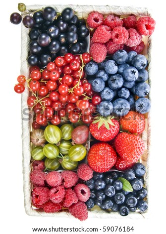 mix ripe berries in the basket isolated on a white - stock photo