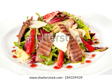 Mix salad with bacon, rucola, parmesan and strawberry