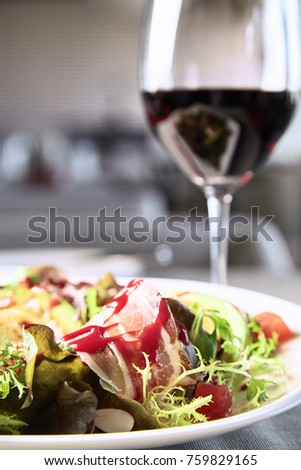 Mix salad with meat and vegetables on restaurant background