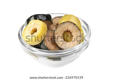 Mix sliced green and black olives on bowl  isolated on the white background  - stock photo