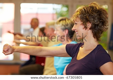 Mixe group working out in a gym - stock photo