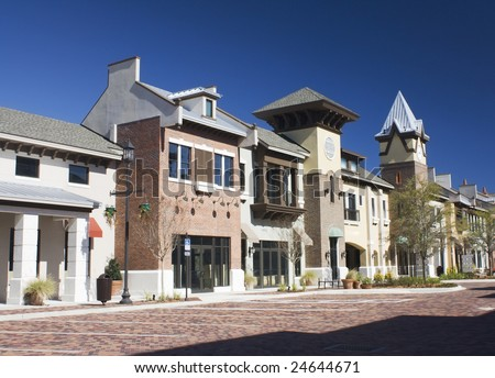 mixed architecture styles commercial strip mall with brick paver parking - stock photo