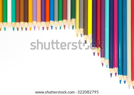 Mixed arranged of rainbow colours wooden pencils on white background, art object