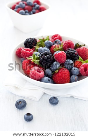 mixed berries in a bowl - stock photo