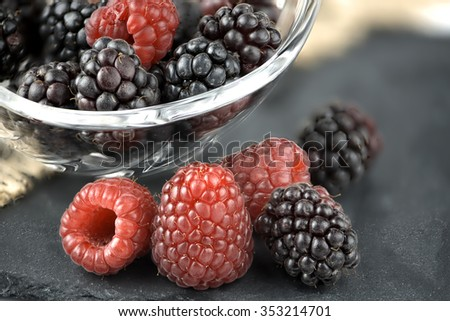 Mixed berries in crystal bowl with selective focus - stock photo