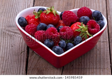 Mixed berries in heart shape bowl