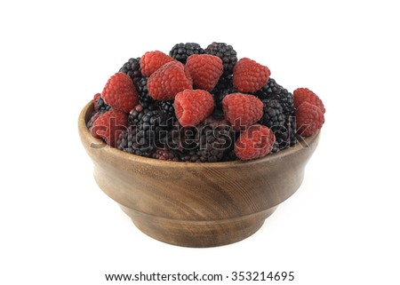 Mixed berries in wooden bowl on white background - stock photo
