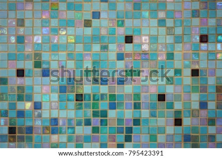 Mixed blue colored square tile mosaic background underwater in a swimming pool