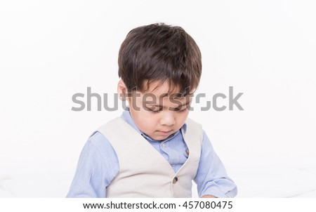 Mixed boy playing tablet on a white background.