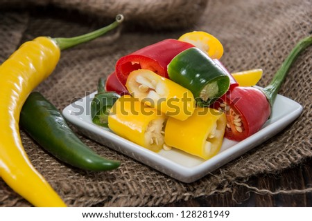 Mixed Chillis on wooden background - stock photo