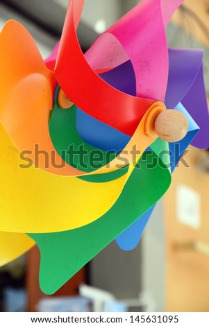 Mixed color Pinwheel, toy fan isolated (with clipping path) Italy - stock photo