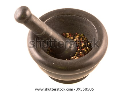 Mixed colored peppercorns with mortar over white background - stock photo