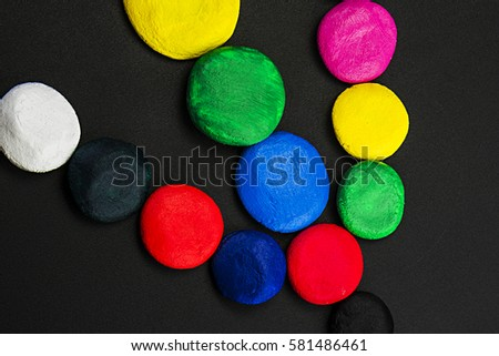 Mixed colors, different size circles, laid out on a dark background, close-up