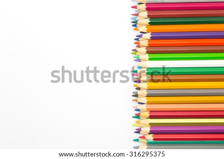 Mixed colors wooden pencil on white background - stock photo