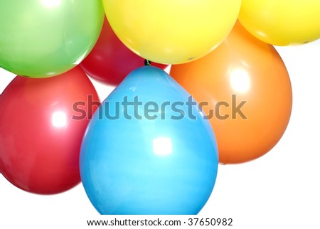 Mixed colours party balloons against a white background - stock photo