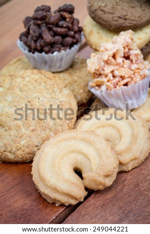 Mixed cookies on wood table background - stock photo