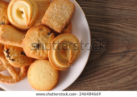 Mixed cookies on wooden background - stock photo