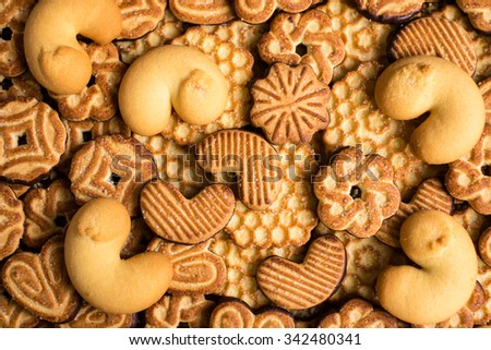 Mixed cookies with chocolate icing and sugar, selective focus - stock photo