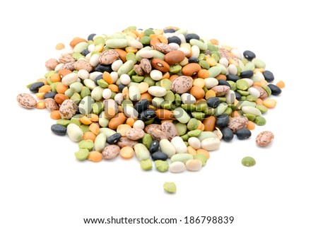 Mixed dried beans - black turtle beans, flageolet beans, pinto beans, brown beans, haricot beans, green split peas and yellow split peas - isolated on a white background - stock photo