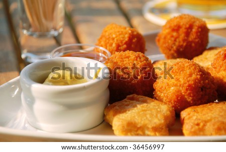 Mixed dutch appetizer with chili sauce and mustard dip. - stock photo
